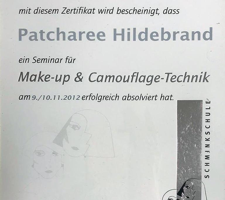 Dies ist ein Zertifikat der Schminkschule Malu Walz für Patcharee Hildebrand über die erfolgreiche Teilnahme an dem Seminar 'Make-up und Camouflage-Technik'